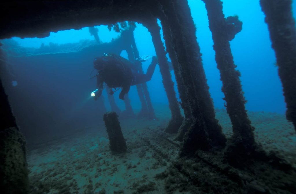 Malta and Gozo Diving holidays Red underwater wreck and diver