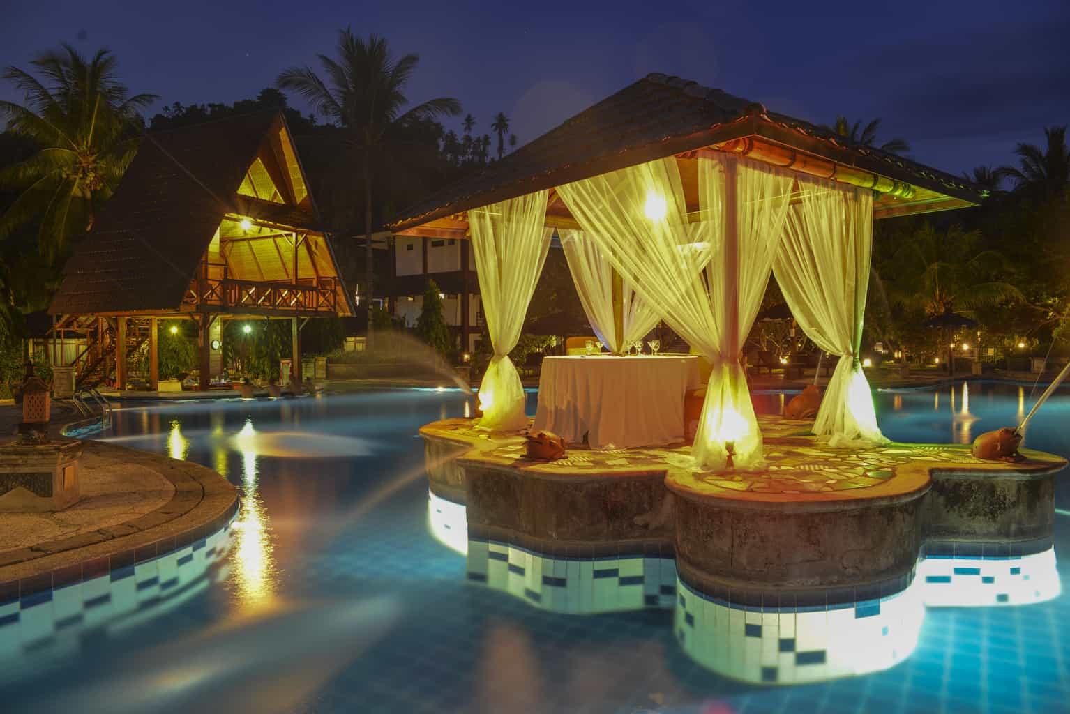 Indonesia Diving Holiday North Sulawesi Tasik Ria Resort Gazebo And Pool Bar Evening