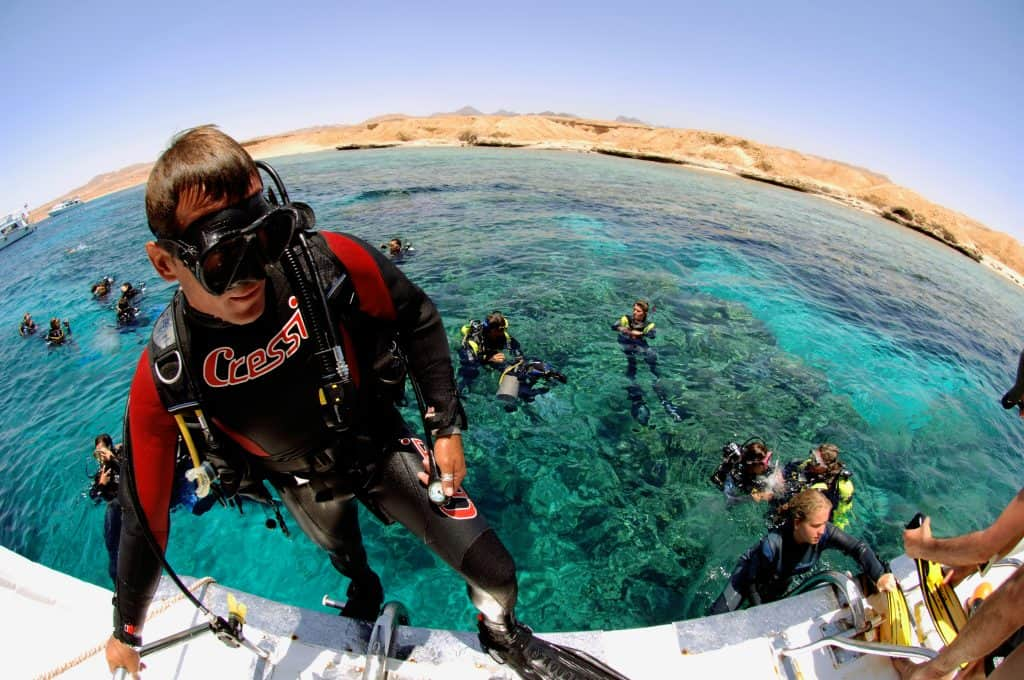 Egypt, Ras Mohammed National Park, Allah Aquarium, Diver On Stern Of Dive Boat